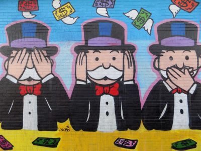Monopoly mural featuring the monopoly man in 3 positions, posed as see no evil, hear no evil, and speak no evil